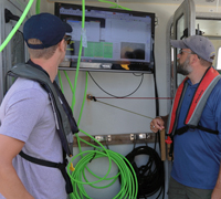 Bootcampers watch the AUV's progress on shipboard monitor
