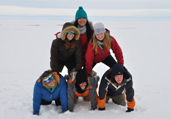 Students forms a human pyramid while on ice liberty during an arctic mapping cruise.