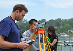 Students use surveying equipment to prepare for a mapping cruise.