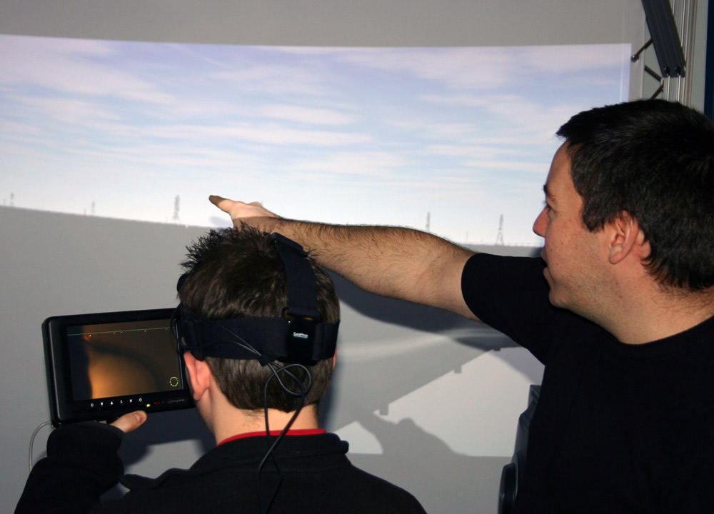 Roland Arsenault helps a visitor use the panoramic display.