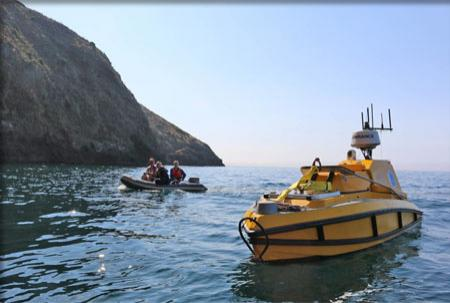 The ASV in open water with a zodiac full of researchers nearby.