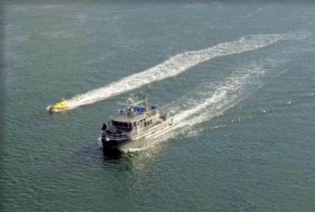 An aerial view of the RVGS and the C-Worker 4 drone cruising side by side.