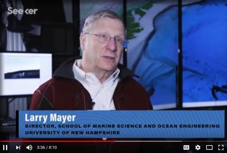 Still from video showing Larry Mayer talking.